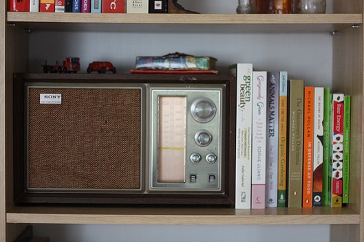Small objects find a cozy place on top of a vintage radio