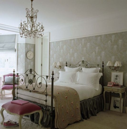 this bedroom is showcased in a traditional style but has elegant