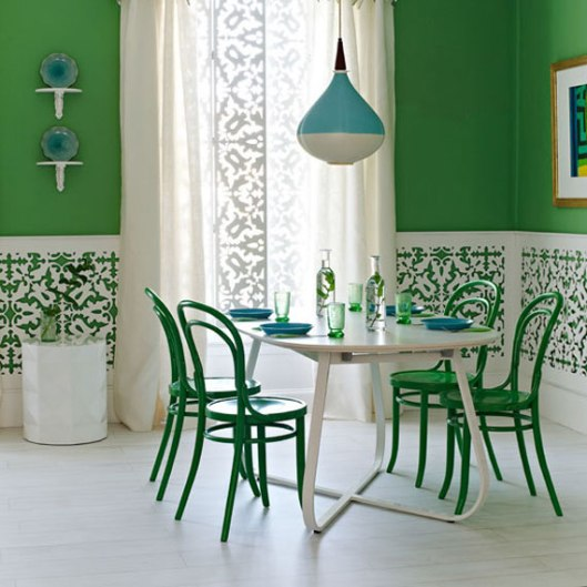 green dining room with white dining table and